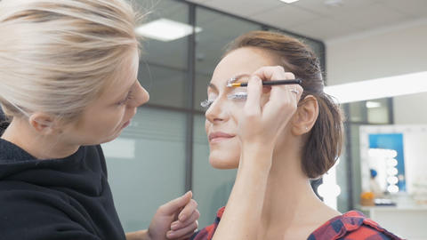 A professional make-up artist does the make-up of the model. Preparing for an Footage