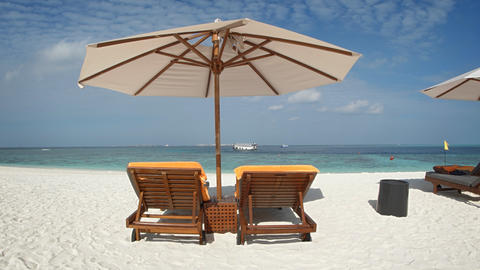Sun Loungers and Beach Umbrellas on the White Sand Footage