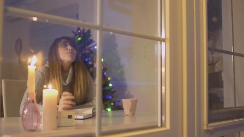 Beautiful girl writes in personal diary Footage
