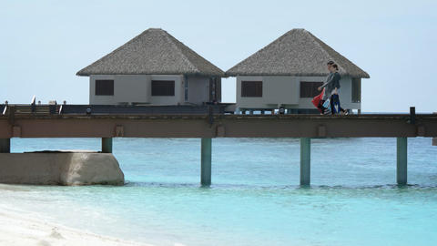 Tourists Stroll along Pier at Adaaran Prestige Vadoo. Resort in the Maldives Footage