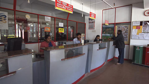Workers Manning Customer Service Counters at Nuwara Eliya Post Office Footage