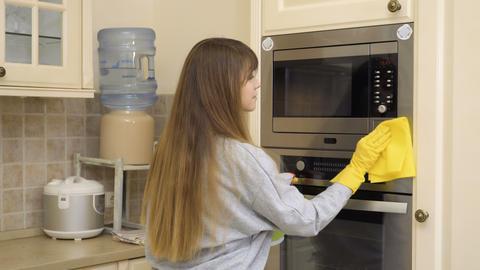beautiful housewife clean oven's door with detergent Footage