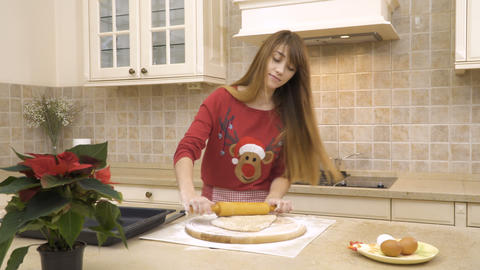 Girl rolls a dough with a rolling pin Footage