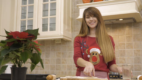 Girl puts raw cookies at the baking tray Footage