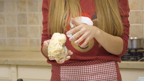 Woman kneads dough for cookies Footage