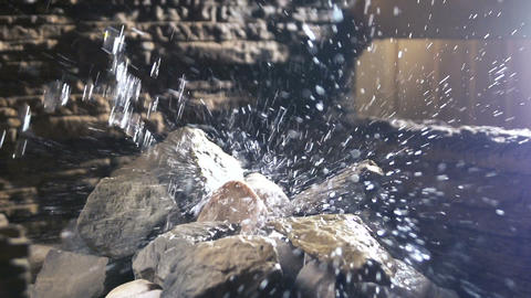 Water flowing on the stone. wellness and spa concept, sauna interior. Slowmo Live Action