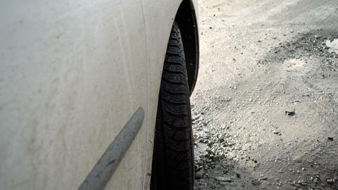 Car tire on a muddy road Image