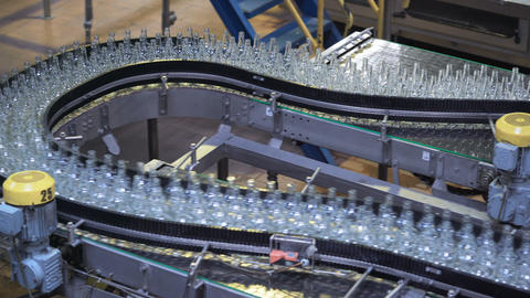 automated industrial chain of bottles drinks. industry automation and robots Live Action