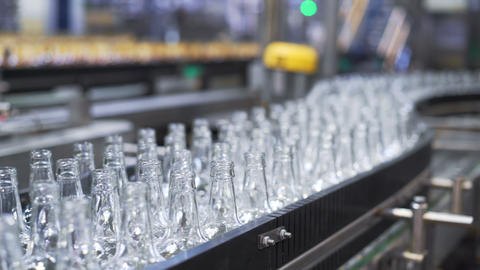 Bottles factory interior with a lot of machines. Close-up Stock Video Footage