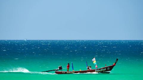PHUKET , THAILAND,DEC 2017 : Tourist boat trips sail near the island of tropical Footage