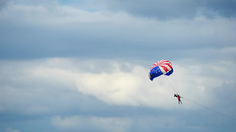 Close up of parachuting or parasailing with blue sky background Footage