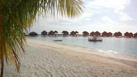 Thatched Roof Bungalows on a Pier at a Tropical Resort Footage