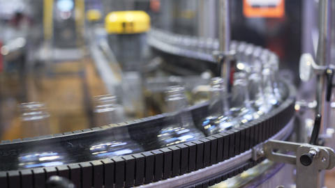 Conveyor belt with glass bottles. production process of alcoholic beverages Live Action