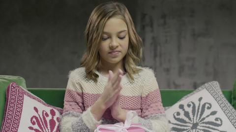 Teenager Girl Opening Giftsitting in Living Room Footage