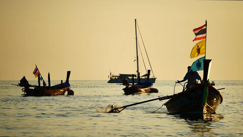 fishermen sailed through group of long-tail boats floating in the andaman sea Footage