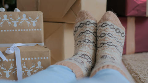 Woman feet in warm socks 画像