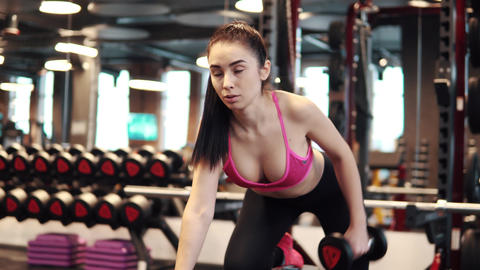 sexy girl with big breasts in sports clothes doing triceps exercises. sports Footage