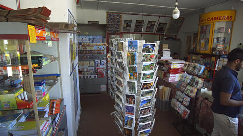 Racks of Postcards. Greeting Cards and Postal Supplies for Sale at post office Live Action