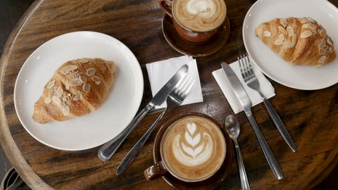 Overhead of gourmet breakfast with fancy coffee drinks such as a cappuccino or Live Action