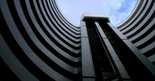 Establishing shot of an elevator going up a futuristic round building shot below Live Action