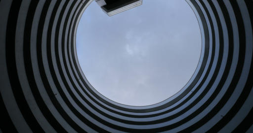 Establishing shot of the sky rotating through the opening of a round futuristic Footage