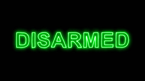 Neon flickering green text DISARMED in the haze. Alpha channel Premultiplied - Animation