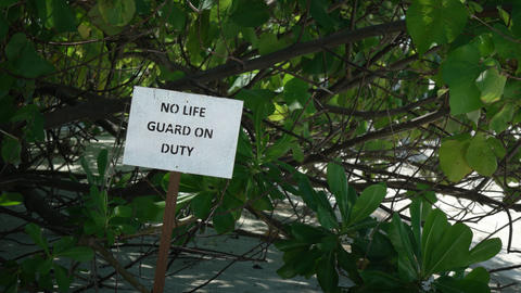 No Lifeguard on Duty Sign at Tropical beach Resort Footage