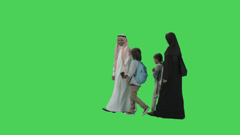 Arabic Adult Parents with two Children walking Live Action