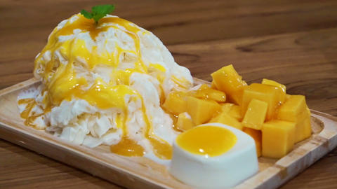 Mango shaved ice with ice cream and custard. Tropical fruit cold sweet Footage