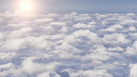 Flying above clouds aeroplane airplane sky stratosphere sun lens flare 4k Footage