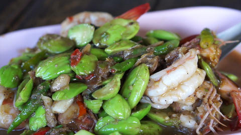 Thai traditional food shrimp fries with parkia. Healthy smelly herb for Thai cui Footage