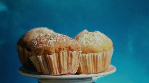 a plate of muffins sprinkled with powder Live Action