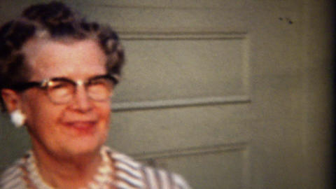 1961: Traditional conservative grandma wearing formal pearl necklace Footage