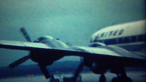 1961: United airplane propeller start burns blows smoke explosion Footage