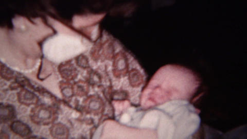 1959: Sick Mom Wears Paper Face Mask Keeps Germs Away From Baby stock footage