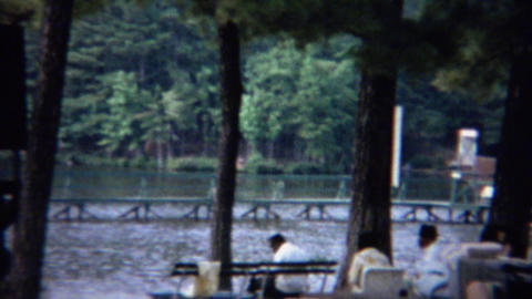 1961: Beach vacation spot picnic tables relaxing recreation area Footage