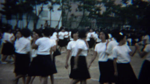 1961: Asian schoolgirl synchronized dancing competition showcase Footage