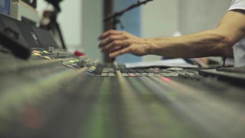 Hand Adjusting Audio Mixer Footage