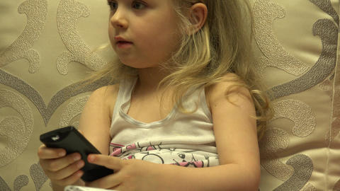 Intelligent Little Girl Press Remote Control, Channel Switching. 4K UltraHD, UHD Footage