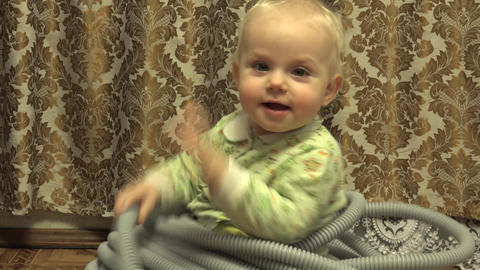 Closeup Baby Girl Sitting in Electrical Corrugated Tube. 4K UltraHD, UHD Footage