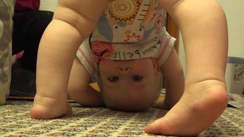 Funny Newborn in Headstand Posture. Closeup. 4K UltraHD, UHD Footage