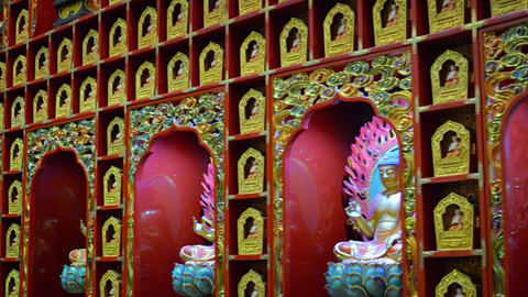Inside the Buddha Tooth Relic Temple in Singapore. Buddha Statues Live Action
