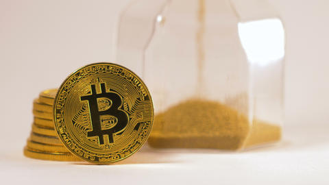Bitcoin Real Model Pile Stands against Hourglass Macro Live Action