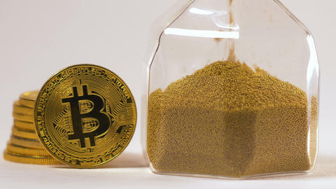 Camera Shows Bitcoin Real Model at Hourglass Macro Stock Video Footage