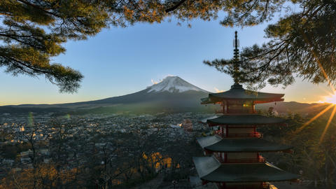 Views of Mount Fuji. Looking through the red pagoda at sunset Photo
