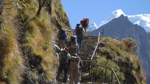 A group of tourists walking along the high-mountain trail in the Himalayas Footage