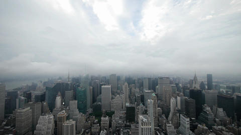City night time lapse nyc skyline foggy clouds Live Action