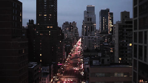 City at night skyline skyscraper nyc new york night lights aerial view flyover Footage