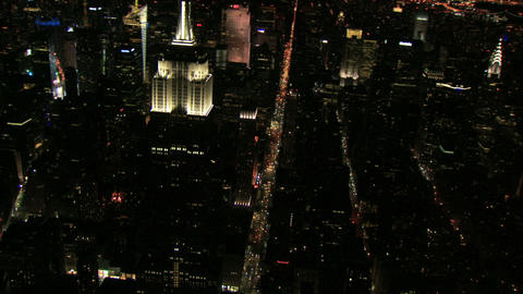 Night aerial circling empire state building Live Action