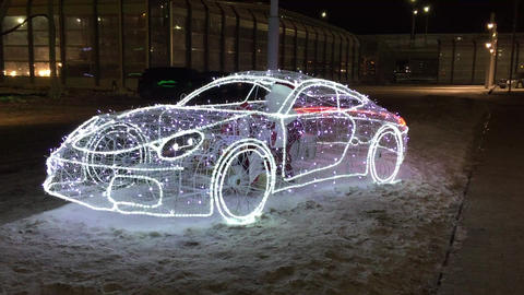 Car frame with flashing lights at night on the street. Cold snow. Santa Claus is Live Action